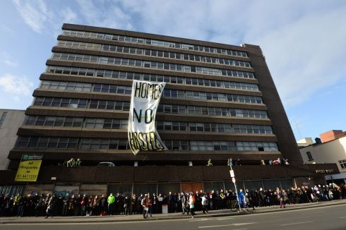 APOLLO HOUSE: Supporters form a human chain around Apollo House in Dublin. Activists occupying the building said they would defy a court order to leave the premises. Photograph: Dara Mac Donaill/The Irish Times