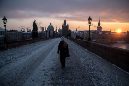EUROPE FREEZES: A woman walks across the Charles Bridge at sunrise during a freezing winter morning in Prague, Czech Republic. Photograph: Martin Divisek/EPA