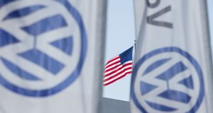 A Volkswagen car dealership in San Diego, California: Along with a $4.3bn settlement  with the US justice department and EPA,  VW will plead guilty to charges, including wire fraud and violating the US Clean Air Act. Photograph: Reuters/Mike Blake