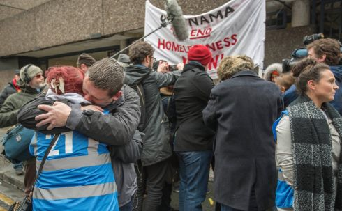 Volunteers hug each other as the last of the homeless leave Apollo House Thursday 12th January. Photograph: Brenda Fitzsimons / The Irish Times