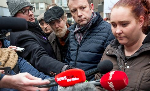 Glen Hansard and Brendan Ogle with Aisling Hedderman of the Irish Housing Network and one of the court injunctees photographed at Apollo House this morning after it was vacated. Photograph: Brenda Fitzsimons / The Irish Times
