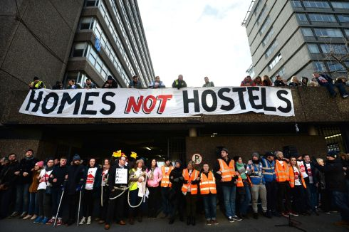 Human chain formed around building by volunteers and supporters gather at Apollo House, Dublin, while the Court hearing was taking place.   Photograph: Dara Mac Donaill / The Irish Times