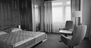 A  guest room in a Moscow Intourist hotel in 1971. When the Soviet Union set up the Intourist hotel and travel company under Stalin, the bellboys, drivers, cooks and maids all worked for the NKVD, the secret police agency later known as the KGB.  Photograph:  Sovfoto/UIG via Getty Images