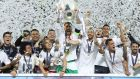 Real Madrid's Sergio Ramos lifts the trophy as his team celebrates winning the Uefa Champions League last year. Photograph: Reuters