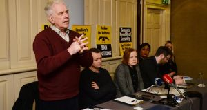 Fr Peter McVerry speaking at launch of the AAA-PBP Anti-Evictions Bill. Also attending were PBP leader Richard Boyd Barrett (centre) and AAA TD Ruth Coppinger. Photograph: Alan Betson
