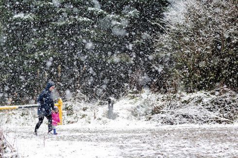 FEAKLE, CLARE: A mother and child take a stroll through snow near Feakle in East Clare. Photograph: Arthur Ellis