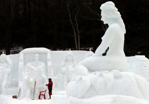 TAEBAEK, SOUTH KOREA: A worker puts finishing touches to a snow sculpture at a park in Taebaek, about 270km southeast of Seoul, South Korea, on the eve of an annual snow festival running until January 22nd. Photograph: Yonhap South/EPA