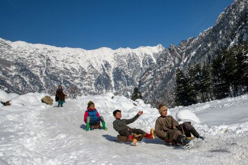 GUND, KASHMIR: Kashmiri children play with sledges on a snow-covered slope near Gund, about 80km north of Srinagar, in India-controlled Kashmir. The Kashmir valley has been experiencing intense cold and widespread snowfall. Photograph: Dar Yasin/AP Photo