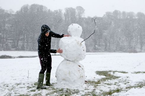 STIRLING, SCOTLAND: Charlie Boldison building a snowman in Stirling, Scotland. Photograph: Jane Barlow/PA Wire