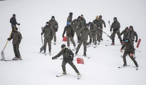 ZAUCHENSEE, AUSTRIA: Soldiers of the Austrian army try to clear the slope of snow for the women's downhill training session of the FIS Alpine Skiing World Cup in Zauchensee, Austria. The training was cancelled due to abundant snowfall. Photograph: Christian Bruna/EPA