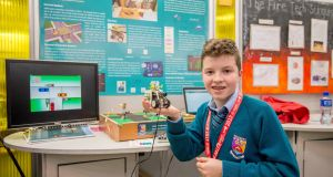 Liam O'Meara (13) from Castletroy College Limerick with his traffic sensor exhibit   at  BT Young Scientist & Technology exhibition. Photograph: Brenda Fitzsimons