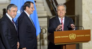 United Nations secretary general António Guterres (right) arrives with Greek Cypriot president Nicos Anastasiades and Turkish Cypriot leader Mustafa Akinci, at a news conference on the Cyprus peace talks, at the United Nations in Geneva, Switzerland on Thursday. Photograph:  Martial Trezzini/Reuters