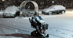 A woman makes her way through the snow on a mobility scooter in Filey on the East coast on Friday. Photograph: John Giles/PA