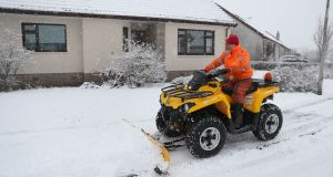 Jim Dunbar plows snow  near Stirling on Thursday, as blizzard conditions are set to bring 'a real taste of winter to the whole of the UK'. Photograph: Andrew Milligan/PA