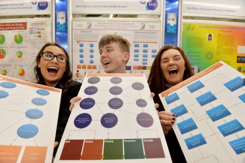"Jennifer Linehan, Fionan Buckley and Grace O'Connor from Millstreet Community School  with their project entitled ""Which  Olympic sport is most suitable for me ?"" at this Years BT Young Scientist & Technology Exhibition.   Photograph: Alan Betson / The Irish Times"
