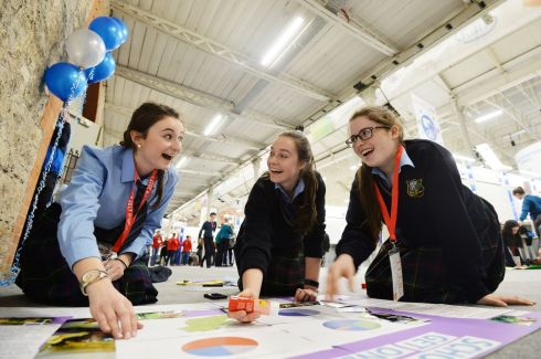 Emma Codd, Emelia Deane and Roisin Condell from Maynooth Education Campus preparing their project on School Buses.   Photograph: Alan Betson / The Irish Times