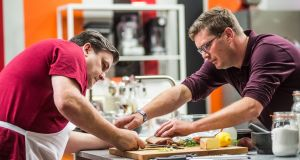 Chef Daniel Clifford (right) lending a helping hand to celebrity MasterChef contestant, actor Simon Delaney