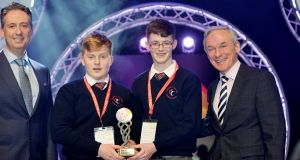 Shay Walsh, managing director BT Ireland (left) and Richard Bruton, Minister for Education (right) with Jack Murphy and Michael Sheehan of Coláiste Treasa, Cork, Winners of the Best Group at the BT Young Scientist & Technologist of the Year 2017 with their project on Prey availability for hen harriers in managed farmland, in the Biological & Ecological Sciences section at the 2017 BT Young Scientist & Technology Exhibition. Photograph: Alan Betson/The Irish Times