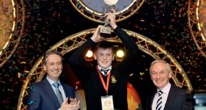 Shay Walsh, managing director BT Ireland (left) and Richard Bruton, Minister for Education (right)  with Overall BT Young Scientist & Technologist of the Year 2017 Shane Curran from Terenure College with his project qCrypt: The quantum-secure, encrypted, data storage solution with multijurisdictional quorum sharding technology in the Technology section, at the 2017 BT Young Scientist & Technology Exhibition. Photograph: Alan Betson/The Irish Times