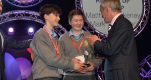 Minister for Education  Richard Bruton with Matthew Blakeney and Mark McDermott  of the Jesus & Mary Secondary School Sligo, Runners-up Group at the BT Young Scientist & Technologist of the Year 2017 with their project Flint on the Moy? A Geological Study of an Area of Shoreline on the Moy Estuary in the Chemical, physical & mathematical sciences section at the 2017 BT Young Scientist & Technology Exhibition. Photograph: Alan Betson/The Irish Times