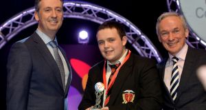 Shay Walsh, managing director BT Ireland (left) and Richard Bruton, Minister for Education (right) with Cormac Larkin of Coláiste An Spoioraid Naoimh, Cork, Runner-up Individual at the BT Young Scientist & Technologist of the Year 2017 with his project on Case Study of Data Mining in Observational Astronomy: The search for new OB stars in the Small Magellanic Cloud in the Chemical, physical & mathematical sciences section at the 2017 BT Young Scientist & Technology Exhibition. Photograph: Alan Betson/The Irish Times