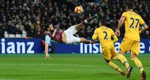 West Ham United's Andy Carroll scores a sensational overhead kick in their Premier League win over Crystal Palace. Photo: Toby Melville/Reuters