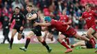 Saracens' Chris Ashton beats the tackle of Scarlets' Tadhg Beirne to go on and score their third try against the Scarlets. Photograph: David Davies/PA Wire.