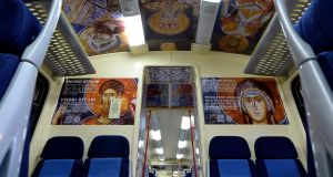 The Serbian train is decorated with images of Serbian Orthodox religious icons from famous monasteries in Kosovo. Photograph: Str Serbia Out/EPA