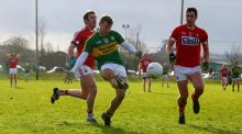 Kerry's James O'Donoghue gets his kick away with James Loughrey and Conor Dorman of Cork in pursuit. Photograph: Cathal Noonan/Inpho