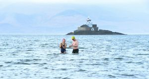 THE PLUNGE: The weekly Winter Swimmers from Tralee Bay Swimming Club  take to the water in Fenit Co Kerry.  The swimmers showed up to brave the 4-degree waters. Photograph: Domnick Walsh/Eye Focus
