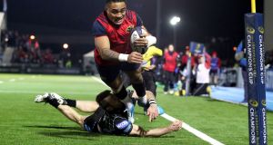 Munster's Francis Saili scores the winning try  at Scotstoun Stadium. Photograph: Dan Sheridan/Inpho