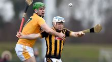 Kilkenny's Jonjo Farrell with Mathew Donnelly of Antrim. Photograph: Tommy Grealy/Inpho