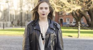 Belle Bradley at Trinity: wearing BDG jeans from Urban Outfitters, earrings from Folkster and a jacket from Nine Crows