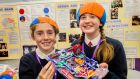 Bobbie Culleton, left (11) and Amy McDonnell (12), from Kilraine National School, Co Wexford, with their Lie Detector machine at the BT Young Scientist & Technology exhibition at the RDS Primary Science Fair. Photograph: Brenda Fitzsimons