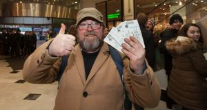 U2 fan Dave Griffith from Terenure after getting his tickets at the ticketmaster branch in St. Stephens Green Shopping Centre, Dublin. Photo: Gareth Chaney Collins