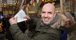 U2 fan Patrick Coughlan from Artaine after getting his tickets at the ticketmaster branch in St Stephens Green Shopping Centre, Dublin. Photo: Gareth Chaney Collins