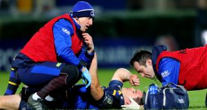Leinster's Johnny Sexton lies injured during their Champions Cup clash with Montpellier. Photo: James Crombie/Inpho