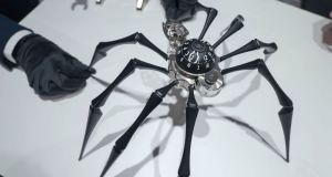 Scenes from the 27th Salon International de la Haute Horlogerie, SIHH in Geneva, Switzerland -  professional fair in fine watchmaking shows the MB&F Arachnophobia clock.   Photograph: Olivier Vogelsang / AFP