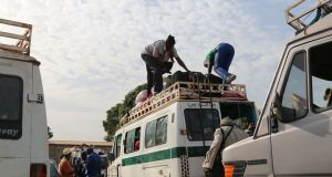 A minibus being loaded at Bundung station in Gambia, as people flee to Senegal amid tensions over the planned inauguration of a new president. Photograph: Lorraine Mallinder