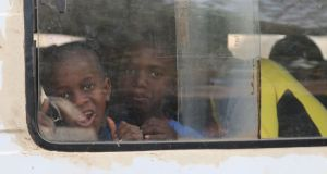 Children on  a minibus from Gambia to Senegal on Monday. Thousands are fleeing Gambia amid fears that long-time dictator Yahya Jammeh will tip the country into war rather than accept a peaceful handover of power. Photograph: Lorraine Mallinder