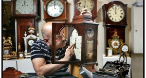 Horologist Kevin Chellar resetting the time on an 18th century mahogany Irish bracket clock by William Boylan of Dublin. Photograph: Matt Kavanagh