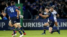 Leinster's Johnny Sexton is tackled by Montpellier's Frans Steyn. The tackle was deemed dangerous enough to merit a red card.  Photograph: Dan Sheridan/Inpho