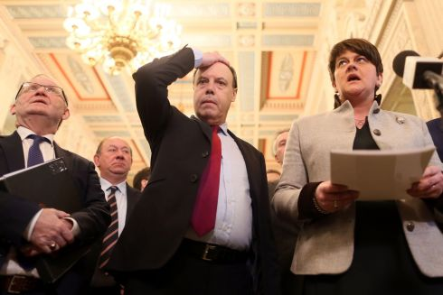 Deputy Leader of the Democratic Unionist Party, Nigel Dodds (C) gestures as Deputy Leader Democratic Unionist Party (DUP) leader Arlene Foster (R) speaks to members of the media in the Great Hall at Stormont before the start of the Assembly in Belfast.  Photograph: Paul Faith / AFP