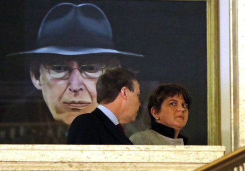 Democratic Unionist Party (DUP) leader Arlene Foster, speaks with Deputy Leader Nigel Dodds (L) as they pass a portrait of Former First Minister, Ian Paisley in the great hall at Stormont.   Photograph: Paul Faith / AFP