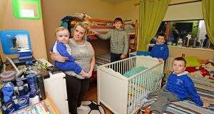 Joanne Bonnell with her children Adam (16), Jake (9), Kyle (6) and Corey (1) , in their accommodation at Ballymun, Co Dublin. Photograph: Eric Luke/The Irish Times
