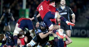 Munster's Conor Murray is tackled by Josh Strauss of Glasgow Warriors during the sides clash at Scotstoun on Saturday. Photograph: Dan Sheridan/Inpho