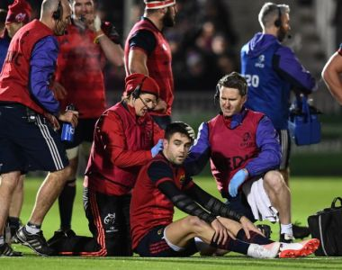 Conor Murray of Munster is treated for an injury during the match against Glasgow Warriors at Scotstoun. Photograph: Stephen McCarthy/Sportsfile via Getty Images