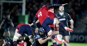 Munster's Conor Murray is hit by Josh Strauss of Glasgow Warriors at Scotstoun. Photograph: Dan Sheridan/Inpho