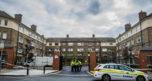 Gardaí at Avondale House on North Cumberland Street in Dublin, where Gareth Hutch was shot dead. Photograph: Brenda Fitzsimons/The Irish Times