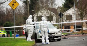 Garda forensic experts at the scene of the murder in the Glebe housing estate in the Esker area of Lucan, Co Dublin, on Wednesday. Photograph: Collins